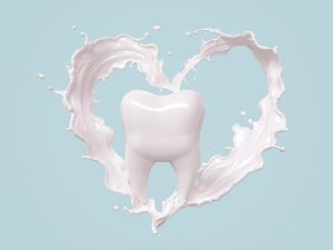 A tooth with milk forming a heart around it