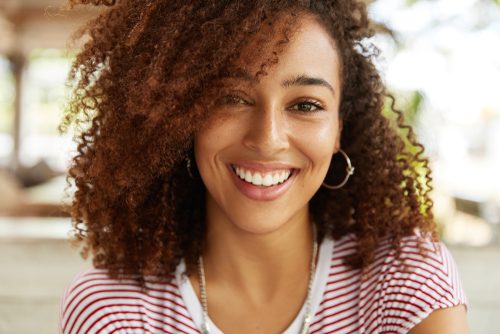 A smiling woman with curly hair