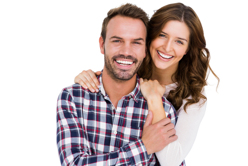 A man and woman with their arms around each other and smiling