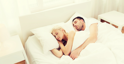 A couple sleeping peacefully in bed