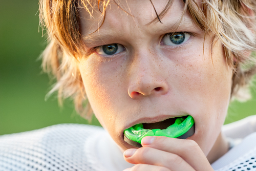 young-child-wearing-a-mouthguard