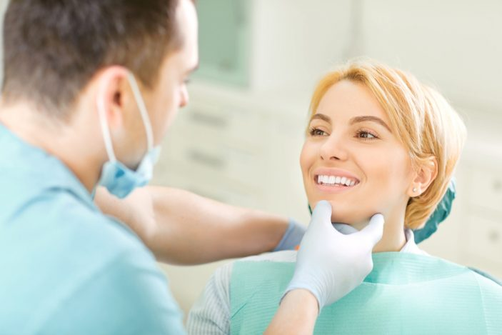 young woman with blonde hair at the dentist getting a check up